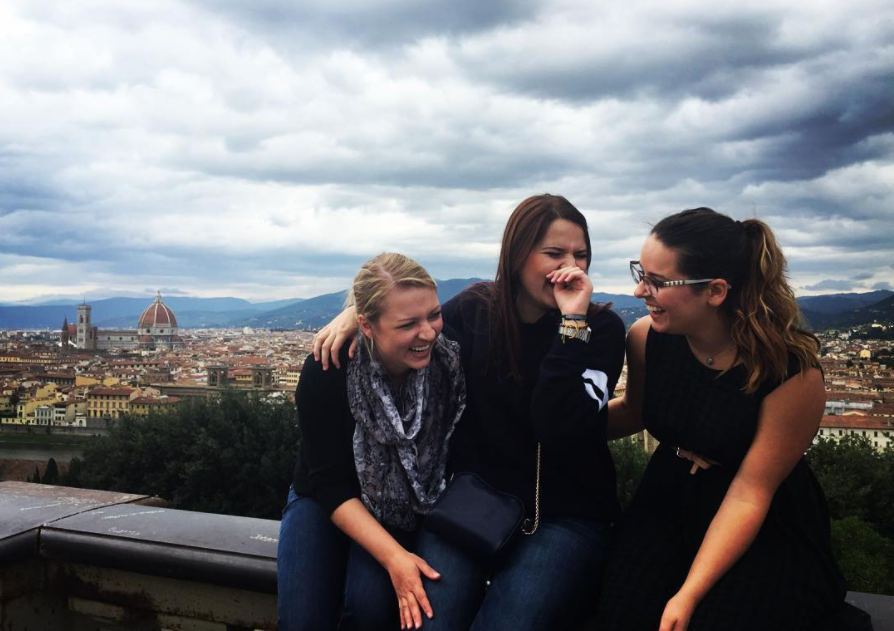 Adelphi students laughing with Florence skyline in background